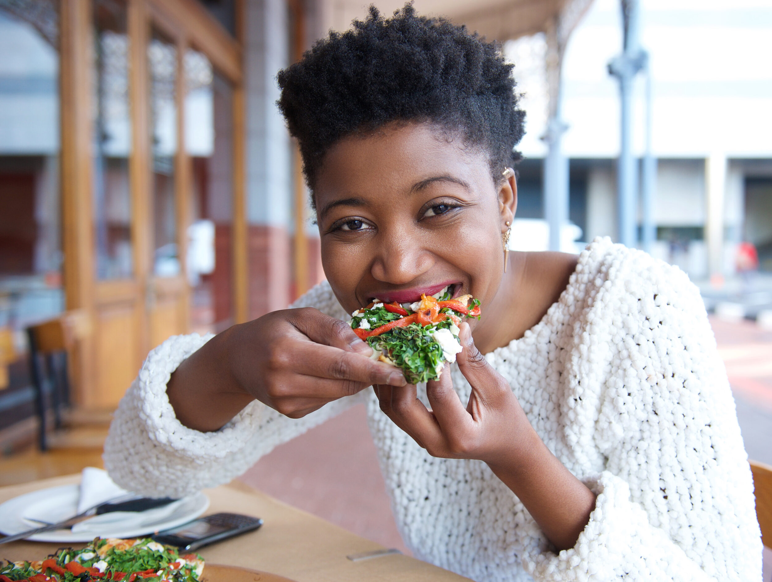 Happy African American Woman Eating Pizza