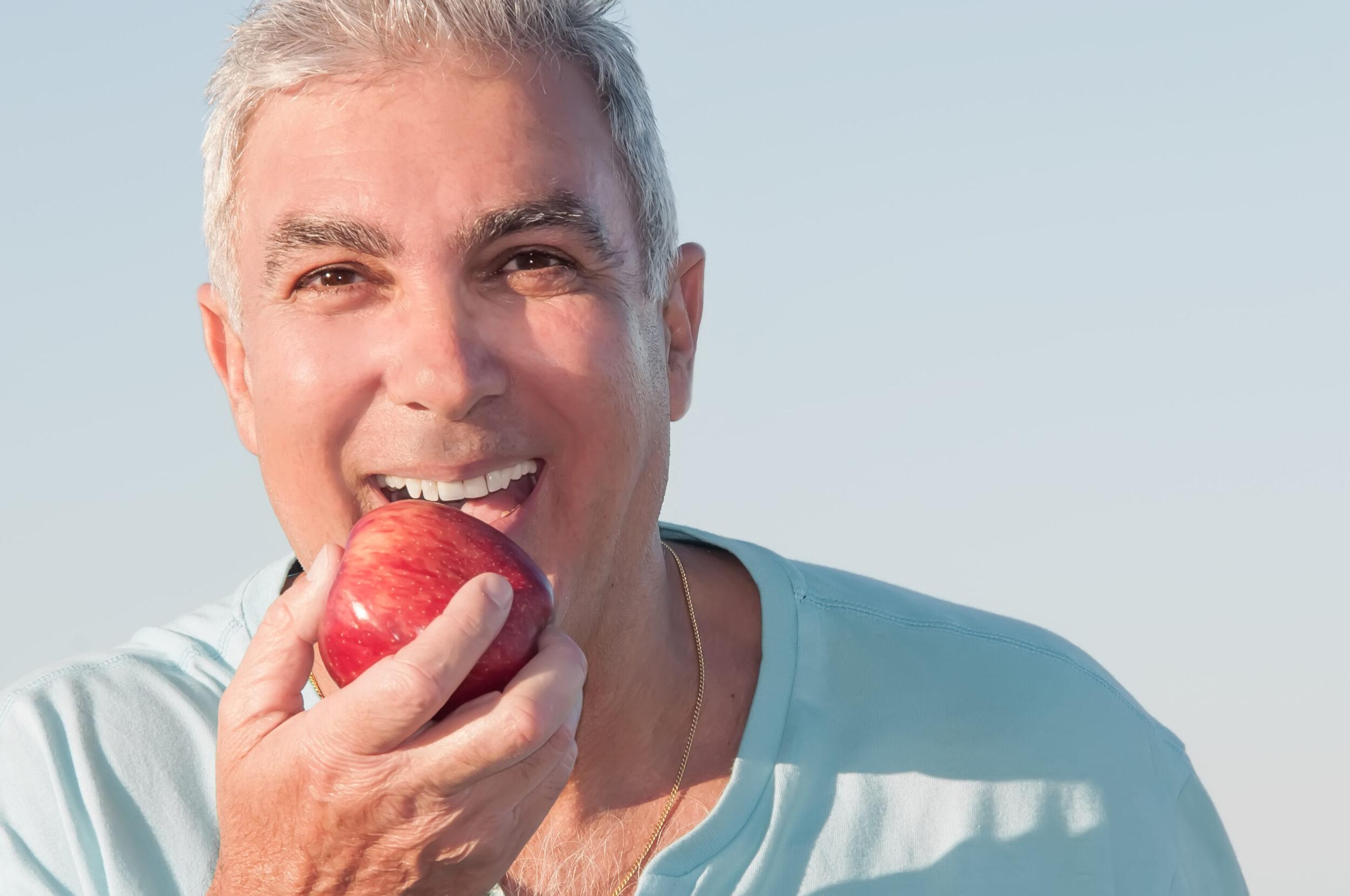 Happy Man Biting Apple